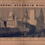 Mon, 2020-09-21 20:55 - The panoramic view of the unique (in the UK) American style 'elevated' railway that ran parallel to the River Mersey and Docks in Liverpool and that was sadly closed and demolished in 1956 - a sad loss. Electrically operated it had connections at the western terminus to the ex-Lancashire & Yorkshire Railway Southport lines. The Railway, serving the Docks workers and commercial areas, also sold itself as a 'scenic tour' as the height of the structure allowed views into the docks to see shipping and liners at this then great port. Just as the bulk of the London Underground is, in fact, overground, conversely the LOR had a tunnel section at its eastern extremity where the line approached the terminus at Dingle.  This guide book cover shows a section of the Railway adjacent to Pier Head and shows the rolling stock and signalling. The booklet dates between 1936 and 1938 as all notes referring to Liverpool Zoo in the guide have been overstamped 'closed' and the zoo did close down in that latter year.