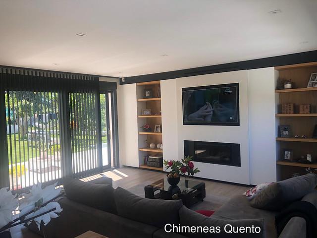 Chimenea Quento modelo Barros con muebles y tv integrados.
