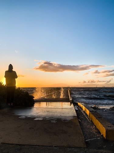 windy melbourne brighton beach waves australia spray sunset clouds woman person silhouette pier