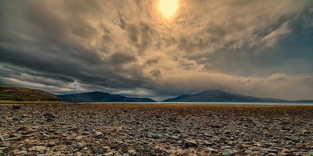 Dark clouds have gathered above Loch Alsh, Scotland.