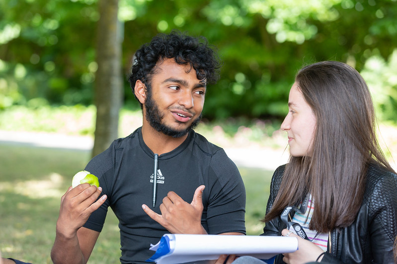 2 students talking together