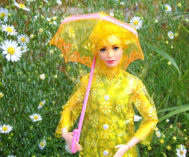 Sunny in raincoat with rain