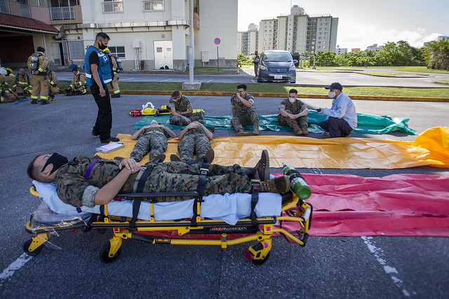 Fire fighters and Marines treat simulated casualties during Constant Vigilance 2020 in Japan