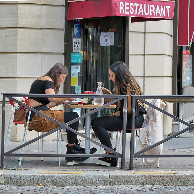 Two girls eating in the street