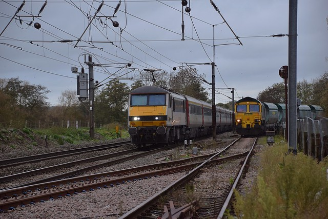 90010 speeds past Barham with the 11.30 Norwich - Liverpool St service, as Freightliner HH 66602 with the 02.26 Aggregate service from Tunstead, is discharging its load. 07 11 2018