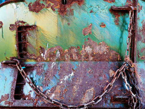 A rust and sea green boat abstract