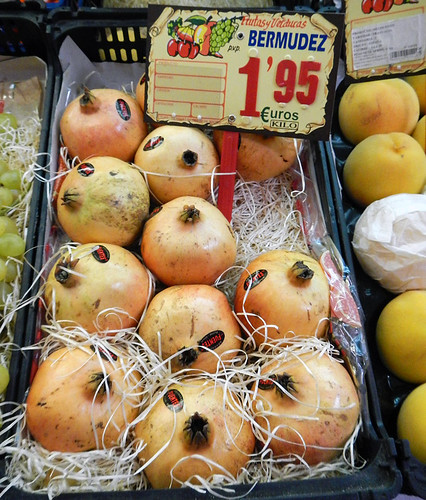 Yellow pomegranates for sale in a Madrid market in Spain