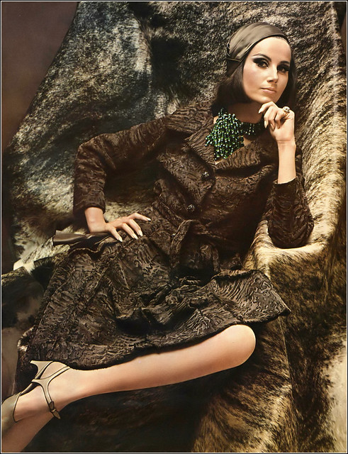 Bettina Lauer in natural-brown Russian broadtail lamb suit by Donald Brooks for Coopchik-Forrest, taupe satin sculptured beret by Mr. John, Laguna jewelry, photo by Helmut Newton, Vogue, Oct. 1, 1965
