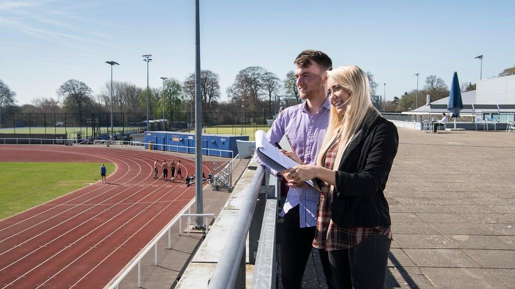 Students overlooking outdoor track