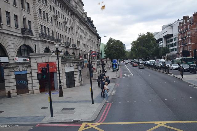 DSC_6370 London Bus Route #205 Lady in Denim Blue Jeans and Headphones crossing Marylebone Road