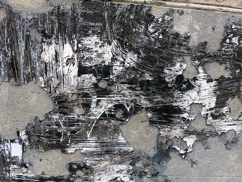 Black & White Abstract in scratched and broken plaster on a concrete wall in Amsterdam, Holland