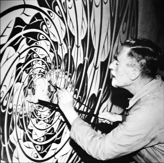 The Artist [Maurits Cornelelius Escher] working at his Atelier