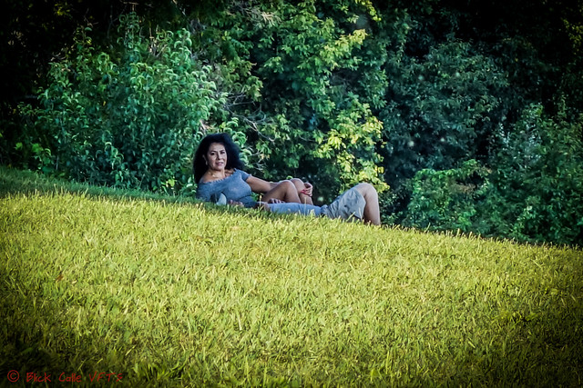 Couple Laying In The Grass