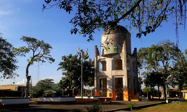 View of the heritage-gazeted Mora and Cañas park, Puntarenas, with the tower of the Ojo de Agua-Punt