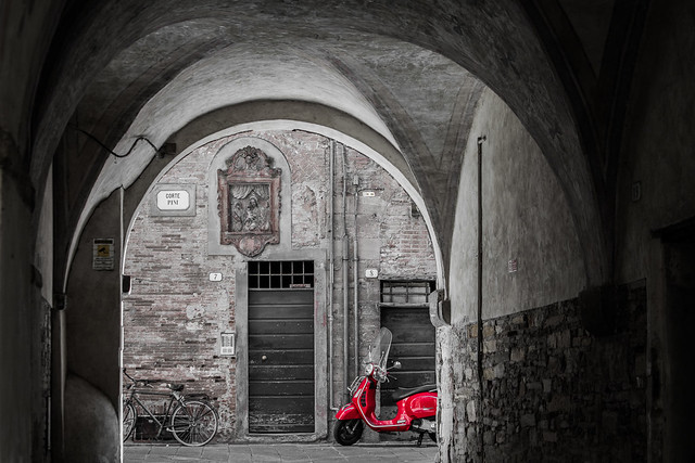 The red motor-scooter