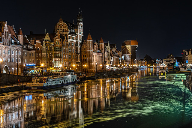 Night view of the architecture of the structures along the Motława river including the Chlebnicka Gate (left), the St Mary's Gate and the Crane Gate, Main Town, Gdańsk, Poland. 949a