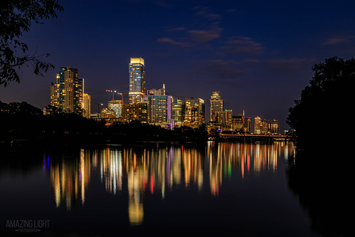 architecture austin bridge building buildingexterior builtstructure city cityscape ladybirdlake lake landscape louneffpoint night nopeople outdoor outdoors reflection sky skyscrapers street texas tourism townlake travel traveldestinations trees