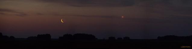 Thin orange Moon crescent and Venus rise