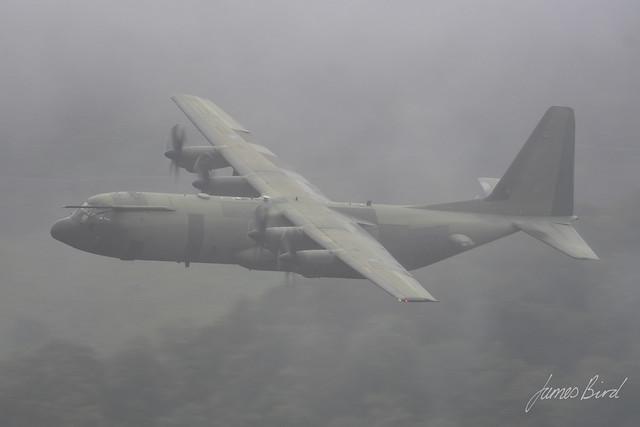 RAF C130J-30 Hercules C4 ZH870 makes its way through a murky English Lake District