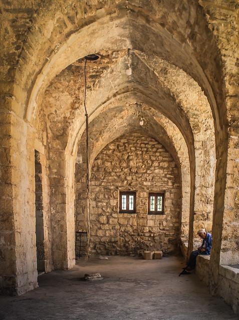 Man praying at the back of a Maronite church