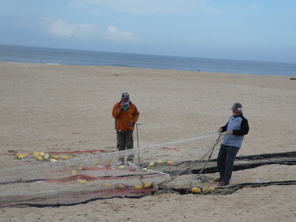 Repairing fishing nets in Espinho, Portugal