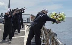 BOHOL SEA (Sept. 27, 2020) Information Systems Technician 1st Class Brandon Baker and Information Systems Technician 2nd Class Luis Contreras lay a commemorative wreath in the water during a Battle of Leyte Gulf Commemoration on the flight deck of the Arleigh Burke-class guided-missile destroyer USS Paul Hamilton (DDG 60). Paul Hamilton is underway conducting operations in support of security and stability in the Indo-Pacific while assigned to Destroyer Squadron (DESRON) 15, the Navy's largest forward-deployed DESRON and the U.S. 7th Fleet's principal surface force. (U.S. Navy photo by Mass Communication Specialist 3rd Class Matthew F. Jackson)