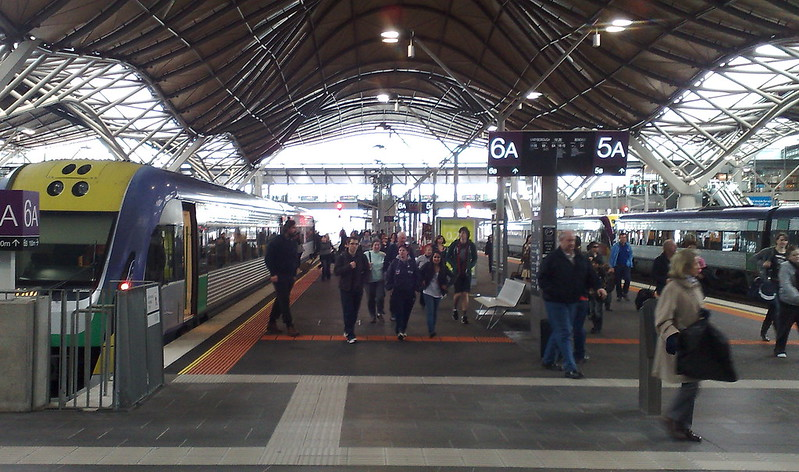 Passengers alight a train at Southern Cross station, September 2010
