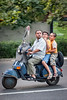 Iranian man and two boys on moped in Tehran by damonlynch