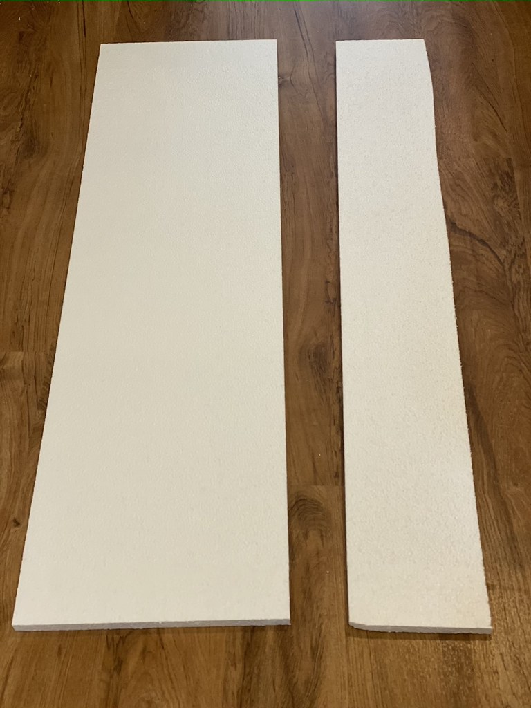 Start making the condemned building decorations by cutting the foam board.