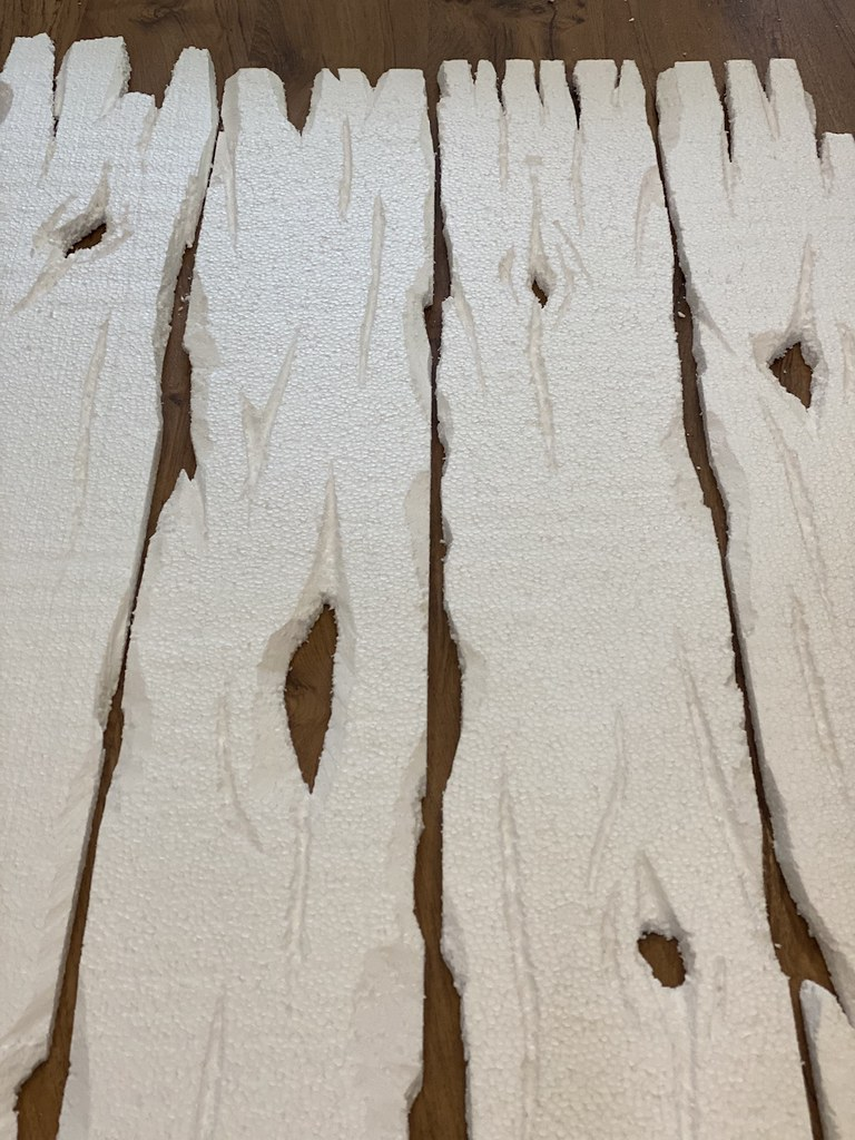 Then, add knots, grooves, and holes into the wood.