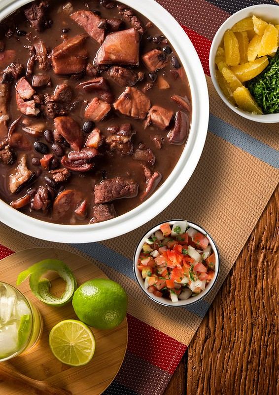 Feijoada - The Brazillian National Dish. Slow cooked meat and black beans doesn't sound all that exciting, but this Brazillian dish is packed with flavour. Serve with a cocktail for the ultimate experience.