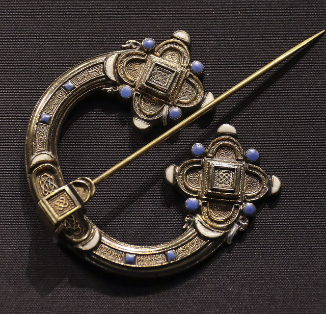 Brooch, Ireland, Dublin, design registered 1849, made by G&S Waterhouse, Gilded silver, with enamel. Copy of the 'Kilmainham' or 'Knight Templear' brooch, Ireland about 700-800