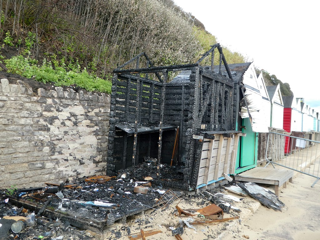 Burnt out beach huts on Bournemouth promenade