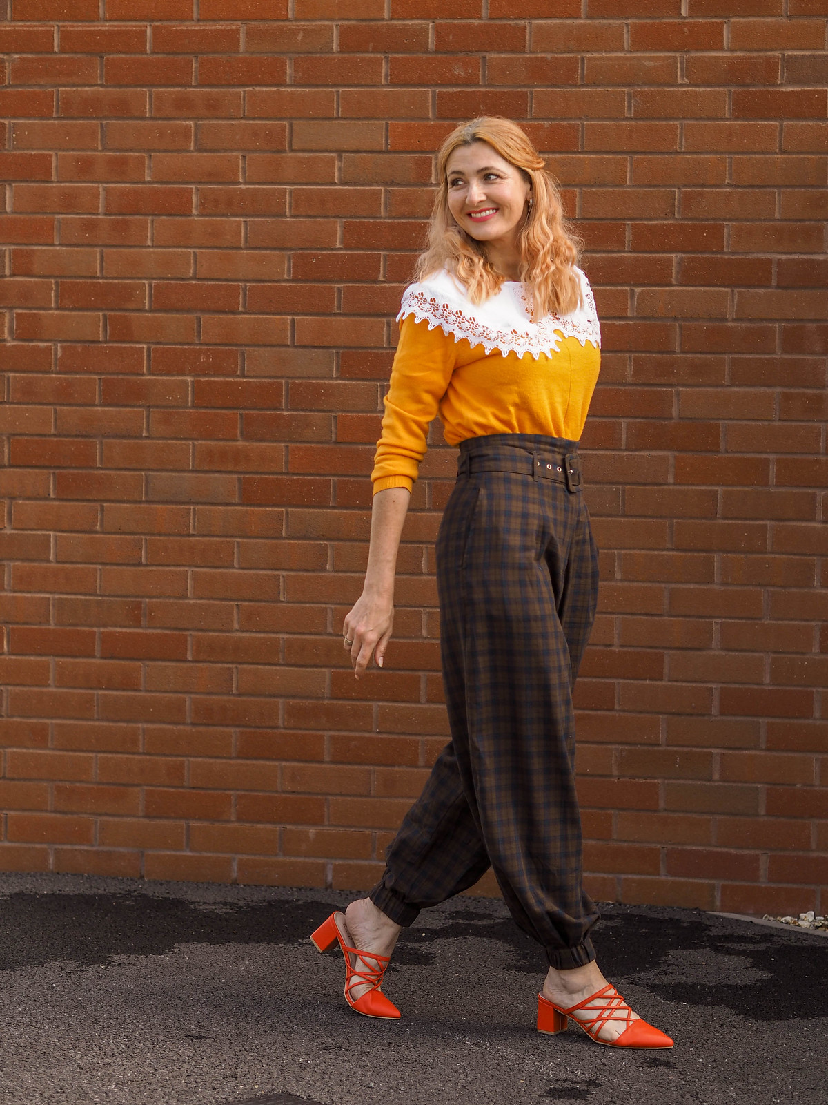 "Asking the ""Is This Outfit Really 'Me'?"" Question: Oversized white lace collar, tangerine orange sweater, brown check balloon trousers, orange strappy mules 