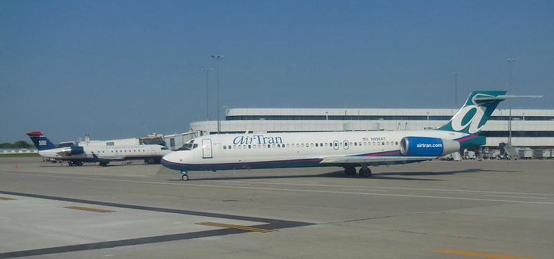 ROC Greater Rochester International Airport A Concourse action AirTran 717 N996AT and US Airways Express CRJ-200 N241PS