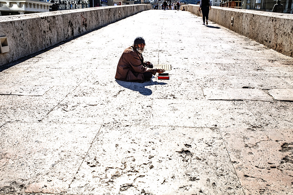 Beggar in the middle of Stone Bridge on 9-29-20--Skopje