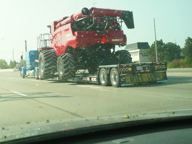 Big red Case Tractor on the highway