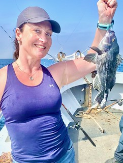 Photo of woman holding a sea bass