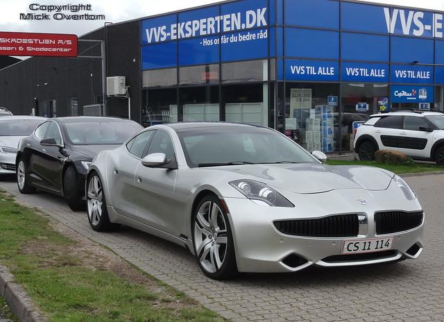 New registration plates CS11114 on this 2011 Fisker seen outside a Copenhagen body shop in front of a Tesla