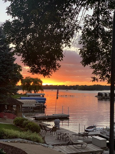 sunset minnesota cellphone minneapolis sunsets twincities iphone priorlake boats boat lakes boating lake trees tree reflections canoe deck canoes sky orange water yellow colorful skies iphonexsmax drunk jetski pontoon cellphonephotography onlyinminnesota onlyinmn motorboat dock