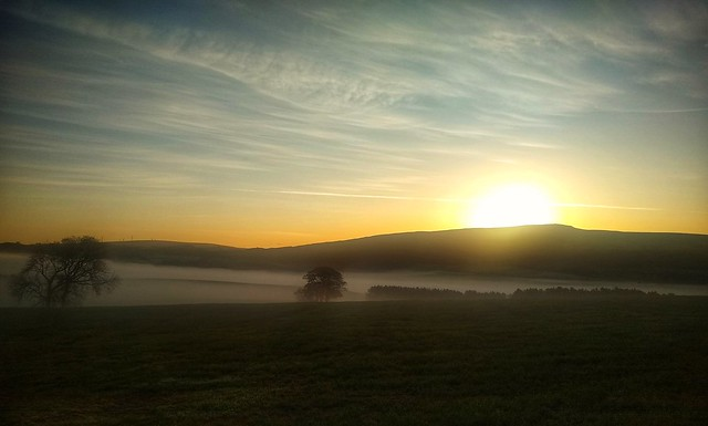 Sunrise over the misty valley...