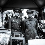 military-clothes salesmen at fair