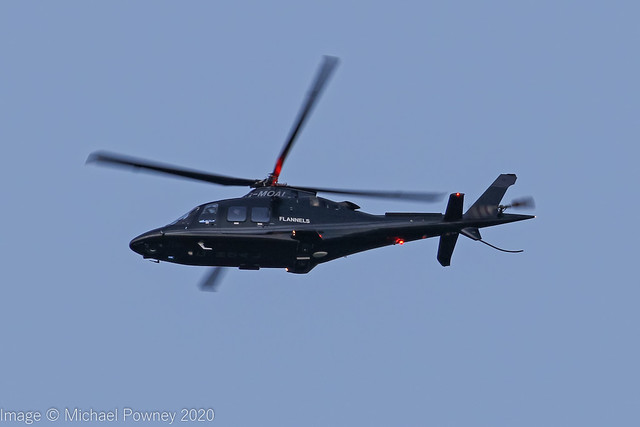 G-MOAL - 2015 build Agusta-Westland AW109SP Grand New,  crossing Manchester airport at dusk South to North en-route Barton