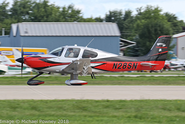 N28SN - 2018 build Cirrus SR22T, arriving on Runway 27 at Oshkosh during Airventure 2018