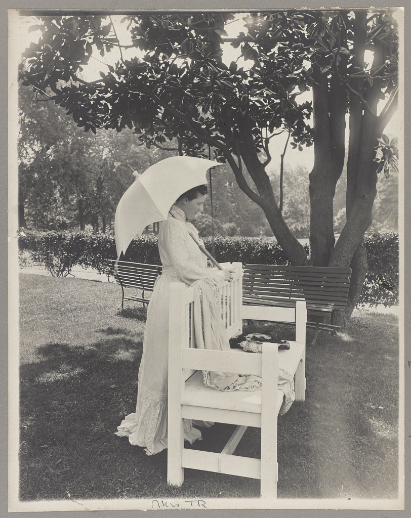[Mrs. Theodore Roosevelt, full-length portrait, standing by bench, facing right; holding umbrella] (LOC)
