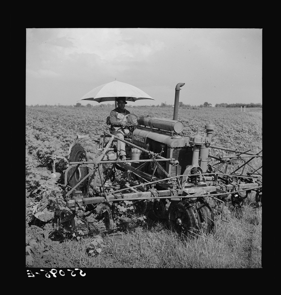Tractors have taken the place of the mule and the plow on Hopson plantation, where day labor is used almost exclusively, displacing the old tenants on the place. Clarksdale, Mississippi Delta, Mississippi (LOC)