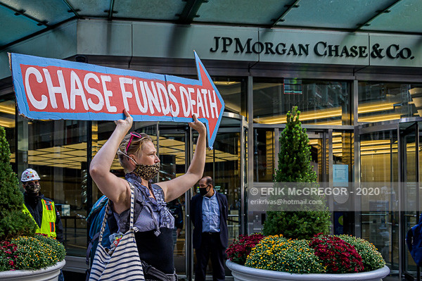Stop The Money Pipeline activists protest at Chase And Blackrock