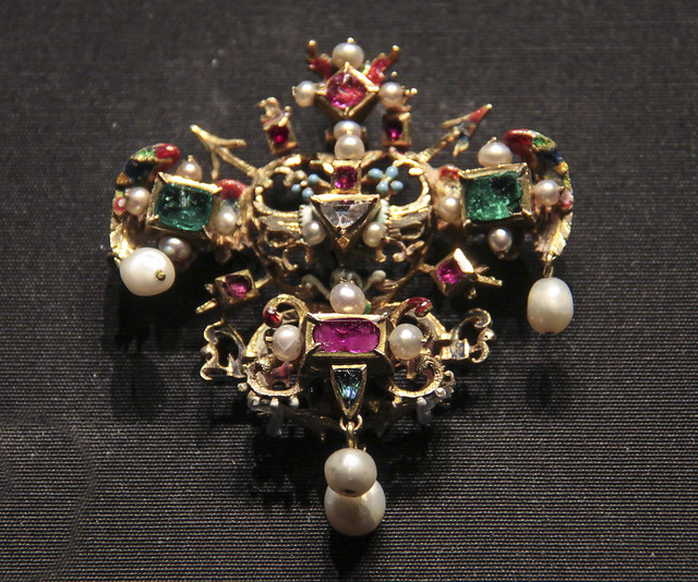 Dress ornament with a winged heart with skull, crossbones and forget-me-nots, Probably Germany, about 1575-1600, enamelled gold with emeralds, rubies, a diamond and pearls