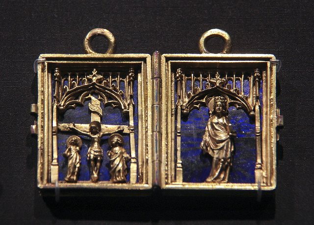 Diptych pendant with the Crucifixion and the Virgin Mary, France, about 1370-80, partially gilded silver andtranslucent enamel