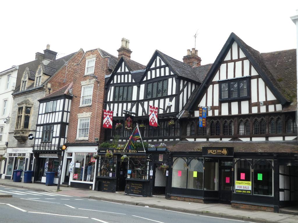 Medieval flags adorn buildings in Tewkesbury
